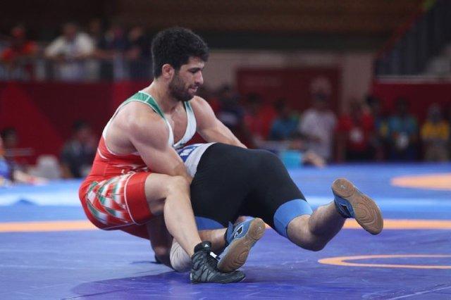 حسین نوری به مدال طلا بوسه زد، 5 طلای کشتی ایران در بازی های آسیایی